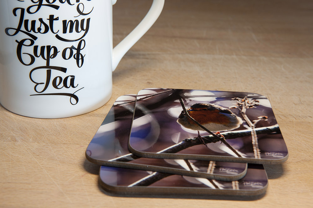 Winter Robin Coaster. Featuring a photo of a robin perched on a tree branch in winter